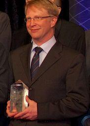 """Daxten-Geschäftsführer Chad Rislov mit dem Deutschem Rechenzentrumspreis 2013 in der Kategorie """"RZ-Energietechnik"""""""