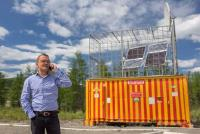 Arbuz Director Kirill Ettenko in front of one of the emergency cabins along Kolyma highway in Russia. Power comes from an EFOY Pro fuel cell/solar hybrid system