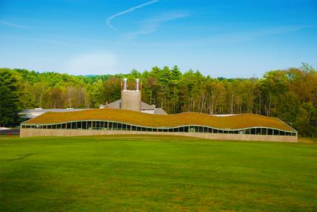 Hotchkiss School, Lakeville, CT - ZinCo system build-up 'Sedum Carpet' - The Biomass Treatment Center is a LEED Gold certified building providing heating for the Hotchkiss School's campus buildings. The green roof blends the