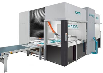 Coating surfaces and edges in one pass - the Ven Spray Vario spray coating machine with inte-grated coating robot and four spray guns for the surface / Photo: Copyright Venjakob