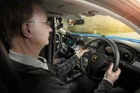 A specially trained driver sits at the actual steering wheel on the right