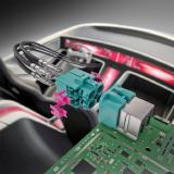 High-Performance Data Transmission in Space Saving Automotive Housing