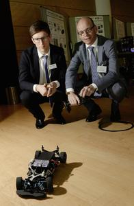 from left: Ladislaus Dobrenizki and Dr. Tim Hosenfeldt from Schaeffler's Surface Technology Center presented a fuel cell powered electric car.