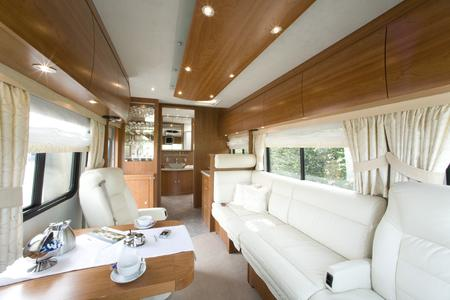 "Motorhome interior ""bentART"" design, American cherry, granite, Corian,  multimedia and kitchen technology at its finest"
