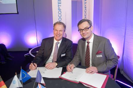 """Tilmann Gabriel President CHC Helicopter (left) signs a long-term training contract with Markus Steinke, Managing Director of Eurocopter UK (right) in Aberdeen"""