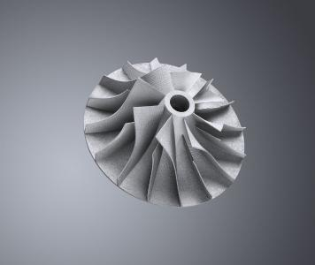 C 0: The layer-by-layer construction of this titanium turbine component prevents the loss of material, which would have occurred, had it been manufactured using a conventional machining process, for example. (Photo: TRUMPF)