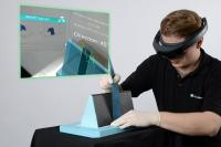 Augmented reality system facilitates manual manufacturing of products made of fiber-reinforced composite materials