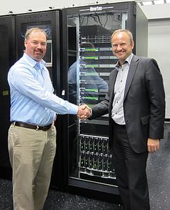(ltr) Garrett Hill, CEO X2nSat, and Serge Van Herck, CEO Newtec, commemorate their partnership