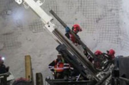 Workers with drill rig