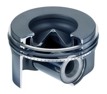 Stahlkolben für einen Dieselmotor: Die Bohrung für den Kolbenbolzen wird bisher nachträglich eingebracht, dabei geht viel Material verloren. Dank eines neuen Umformverfahrens soll sie künftig schon während des Schmiedens entstehen. (Quelle: Kolbenschmidt Pierburg AG)
