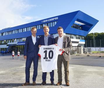 Working together for youth development: Dr Dieter Gudel, head of the HSV youth training centre, Ronald Hoppmann, WISKA general manager, and Heribert Bruchhagen, HSV CEO, in front of the sport club's newly built campus building