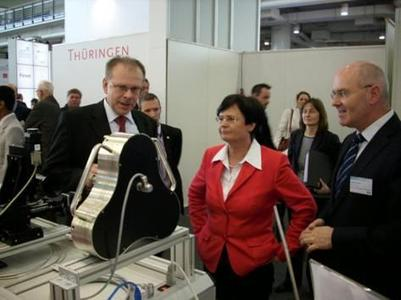 "Thuringia""s Minister-President C. Lieberknecht with Dr. D. Weber (μ-GPS, left) and LEG Thuringia""s Managing Director A. Krey at the μ-GPS booth, Foto: CITY-PRESS, P. Schmalfeldt"