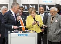 Federal Chancellor Dr. Angela Merkel visits the Festo stand