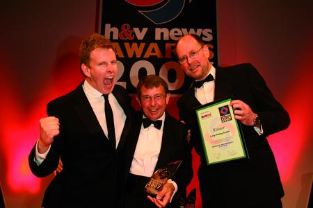 Laing's sales Representative Brian Brown from Huntingdon Pump (middle) receives the award for Domestic H&V Product of the Year from Rowan Crowley, event director of sponsor H&V09, and from TV personality Patrick Kielty (left).