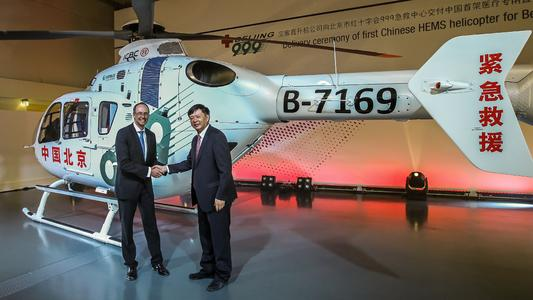 Mr Wolfgang SCHODER, CEO Airbus Helicopters Germany, handing over the EC135 to LI Libing, General Director of Beijing 999 , © Copyright:  Airbus Helicopters, Charles Abarr