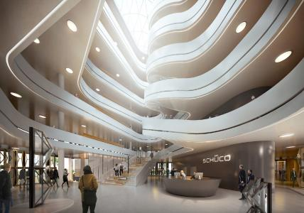 Das dynamische, über sämtliche Ebenen gestaltete Atrium ist architektonisches Highlight und zentraler Sammelpunkt des Gebäudes. Das Raumkonzept des Neubaus sieht eine offene kommunikationsfördernde Arbeitslandschaft vor, um den Dialog und Wissensaustausch der Mitarbeiter und Mitarbeiterinnen zu fördern (Foto: 3XN Architects)