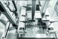 The standard automatic transport system has a servo drive for exceptionally gentle workpiece transport and part-specific lift-out for pre-drying parts as they leave the last tank.  Image source: UCM AG