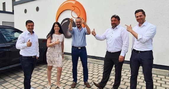 Gruppen Bild Vodafone und Epsilon: v.l.n.r. Dimitrios Nikolaidis (Vertriebsleiter Epsilon Telecom), Karin Lia Temmen (Vodafone), Christian Krug (Geschäftsführer Epsilon Telecom), Martin Schreiterer (Vodafone), Hendrik Baumgarten (Vodafone)