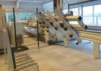 Auf dem Weg zu Industrie 4.0: Roboterbeladung des doppelseitigen Kantenautomaten