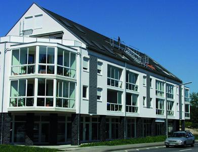 Wohnlösungen von Neher Multiraum in einem Mehrfamilienhaus. Das System lässt sich flexibel an bauseitige Gegebenheiten anpassen