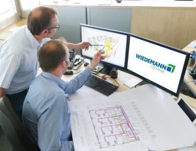 Konstruktiver Austausch im WTB-Team während des Planungsprozesses