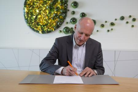CEO Remo Brunschwiler signing the Climate Pledge HR