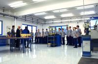 Einweihung der neuen Ausbildungswerkstatt mit der Elektror Geschäftsleitung und den Auszubildenden