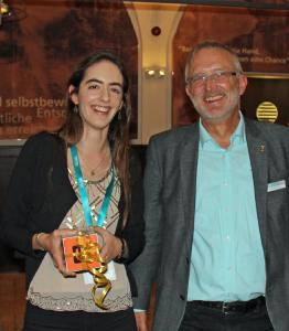"""Birgit Bräuer, winner of the 2019 WITec Poster Award (left), with WITec's managing director Joachim Koenen (right) at the award ceremony. Her poster titled """"Surface Characterization of Escherichia coli-imprinted Polymers using Confocal Raman Microscopy"""" presents a method for detecting bacteria using Raman microscopy."""