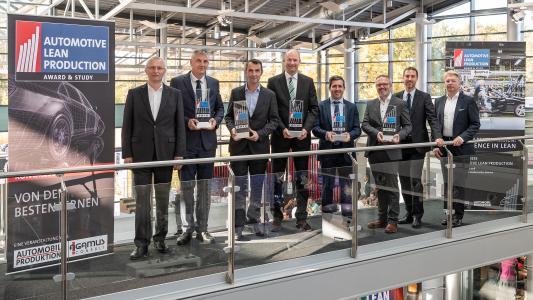 Die Gewinner der Automotive Lean Production Awards: Dr. Werner Geiger (Agamus Consult), Dr. Stefan Loth (VW), Pierre Guédès (Magna Mirrors), Dr. Jochen Stallkamp (BMW India), Manuel Mansilla (Iveco), Patrick Vogel (Poppe), Marc Kräutle (Agamus Consult), Dirk Reusch (Media-Manufaktur)