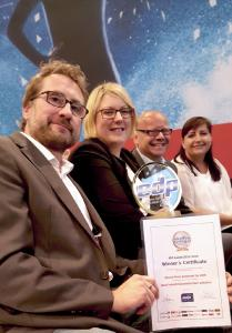 """Celebrations after the award ceremony (from left): """"Martin Schach, Head of Printing Technology, Katrin Preckel, Head of printing team, Dr. Peter Stelter, Executive Vice President Strategy & Technology Management (all KHS) and Kristina Yabar-Jilka, NMP Systems."""""""