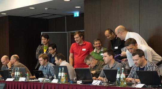 XIMEA CEO Max Larin (center, green shirt) talks with other attendees of the AIA/EMVA USB 3 Vision standard development plugfest held in Dresden, Germany