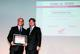 "Antonio Marcondes de Almeida Filho, Senior Vice President Sales and R&D Indus-trial – South America at Schaeffler Brasil (left), took over the ""Moto Honda Certificate of Merit"" by Paulo Takeuchi, Director Institutional Relations Honda South America, during the award ceremony on April 26, 2012 in Saõ Paulo"