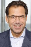 Helmuth Ludwig, Chief Information Officer (CIO) bei der Siemens AG, zeigt in seinem Vortrag auf der MHLC Europe, wie sich Unternehmen durch Digitalisierung optimieren lassen. (Foto: Dematic)