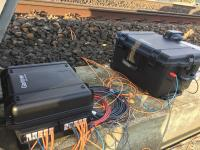 In operation with additional battery box for temporary vibration and axis load measurement on a railway bridge (right)