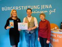TAF übergibt Spendenscheck an Bürgerstiftung Jena
