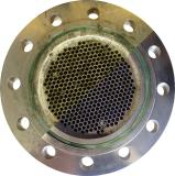 Tube bundle heat exchanger made of stainless steel before and after cleaning with TubeMaster