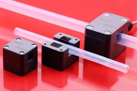 Range of differently sized SEMIFLOW ultrasonic flow sensors for non-contact liquid flow measurement on hard plastic tubes and pipes