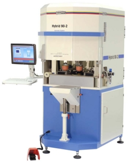 Interlinked process consisting of standard tampon printing machine, laser system and robot feeding