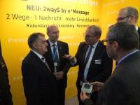 Innenminister NRW bei e*Message PMRExpo2017: Minister Herbert Reul, Andreas Gegenfurtner, Dr Dietmar Gollnick (v.l.n.r.) / Foto: Copyright eMessage