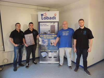 Willy Küches von meteo aachen (Zweiter von rechts) und das Software-Entwicklerteam der Firma Qosmotec