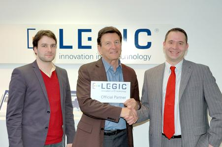 Ron and Gabriel Shiller from BadgeCom and Hanspeter Kündig, Area Sales Manager at LEGIC, look forward to a successful partnership