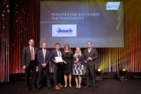 The Jauch representatives accept the award on stage