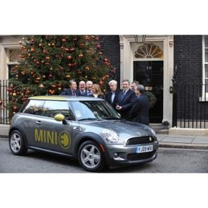 Prime Minister Gordon Brown and Business Secretary Lord Mandelson welcome the first all-electric vehicle - a MINI E - to be used in the Government car pool for Ministerial business around London