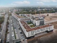 Blick auf das Quartierszentrum, das Herz des neuen Stadtviertels im Mainzer Stadtteil Weisenau. Das Gebäude überzeugt optisch mit luftigen V-Stützen und fungiert damit als Tor in das neue Quartier. Bild: Hitzler Ingenieure