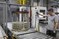 Tauchschleuder-Anlage im Werk Obrigheim: Verbesserung des Korrosionsschutzes und der tribologischen Eigenschaften von Bauteilen mit komplexen Strukturen