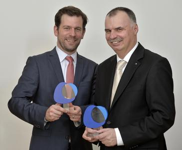The ALTANA Innovation Award 2013 goes to the winner team of ACTEGA Terra: Timo Kondziela (left) and Frank Kamphuis (right) received the award in Wesel, also on behalf of Tim Kammer and Marcel Altenburg