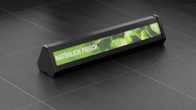 Warentrenner mit Digital Signage steigern den Umsatz am Point-of-Sale