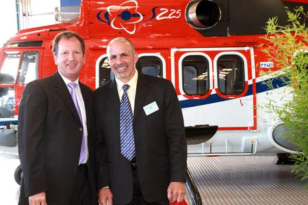CHC President and CEO William Amelio (right) and Lutz Bertling, Eurocopter's President and CEO (left)