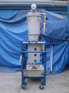 The Stollberg Flux Feeder is a compact unit requiring little space on the casting platform.