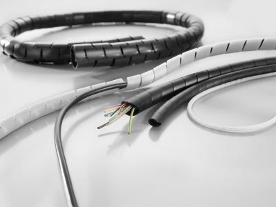 Weidmüller Kabelschutzschläuche: Spiral und Netzschläuche eignen sich vor allem zum Aufbau raumsparender Leitungsführungen in Schalt- und Steuerschränken